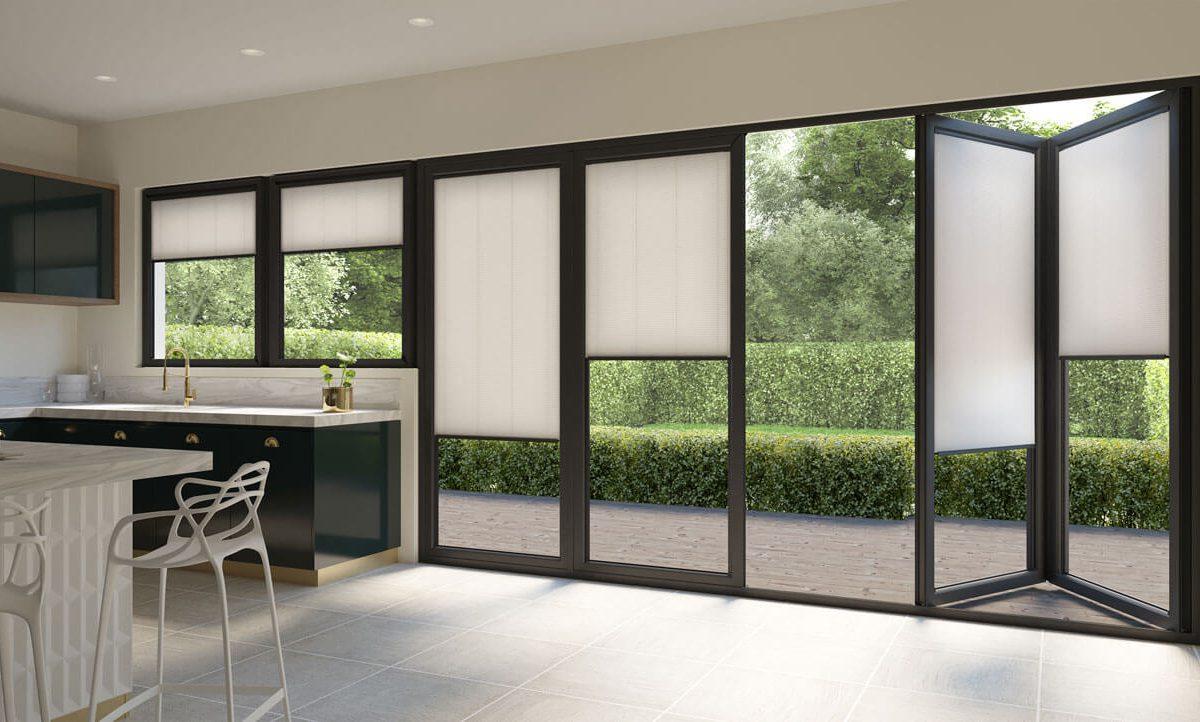 White bi-fold doors conservatory blinds