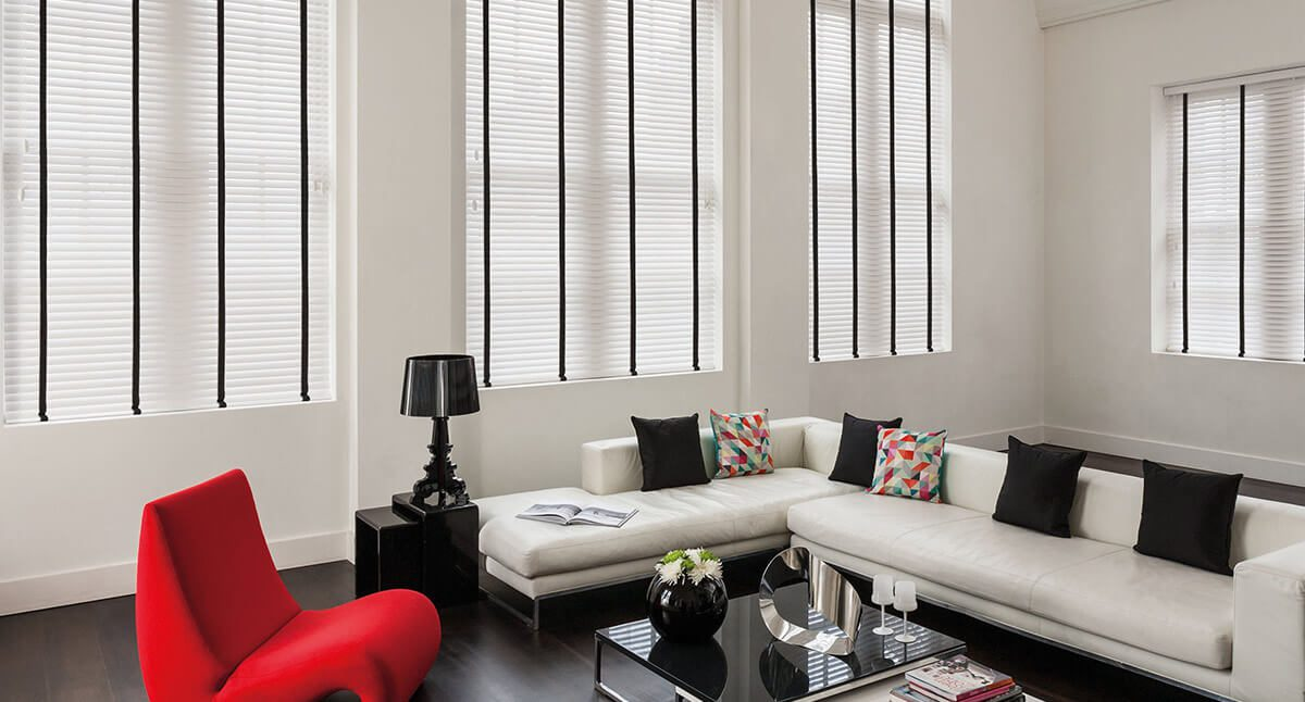 White and black wooden blinds in modern living room
