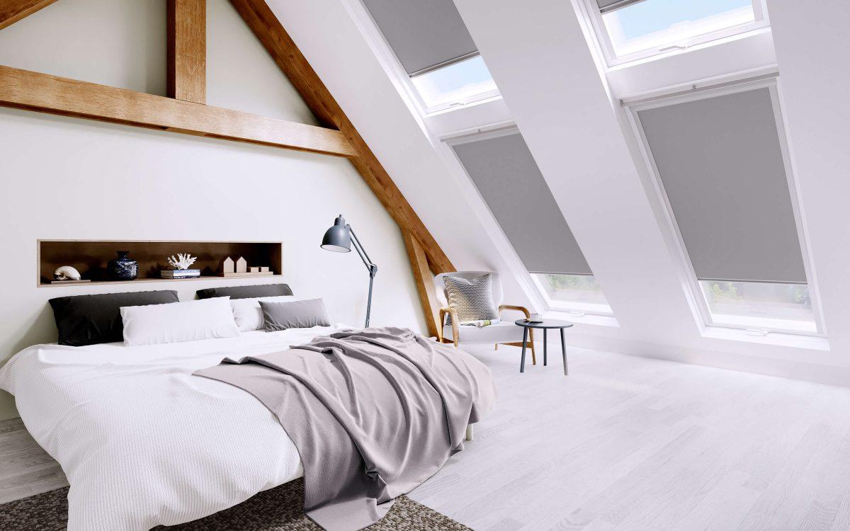 Grey vitra flint roof blinds in loft bedroom