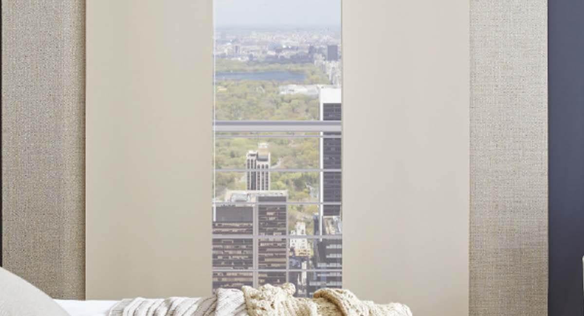 Cream panel blinds in modern bedroom
